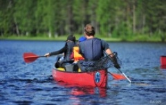 canoeing a lake in Finland