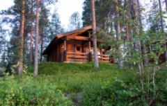 traditional wooden chalet hidden in the Finnish woods