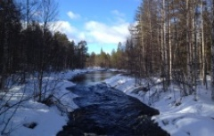 beautiful frozen river in snowy taiga forest